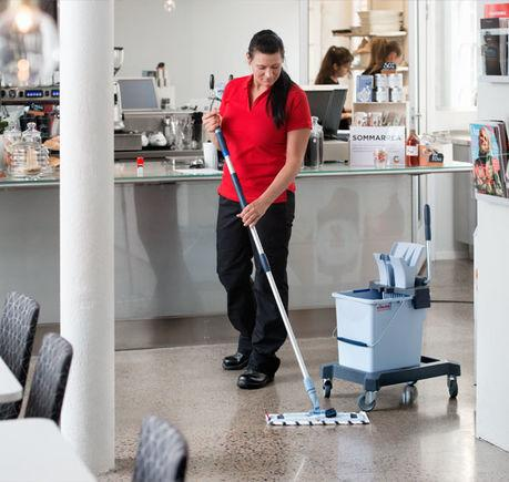 Woman using Vileda Ultraspeed Mopping Kit on a Terazzo floor
