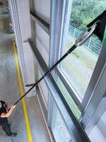 How can I clean high external windows without using a ladder?