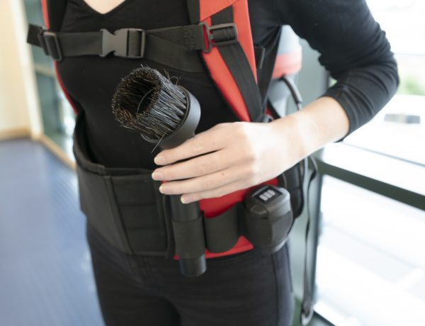 Woman showing Tool kit storage for RSB150NX