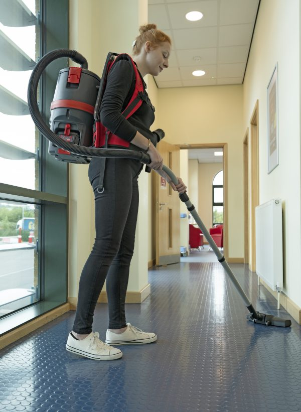 Woman Wearing RSB150NX Vacuuming a rubber floor